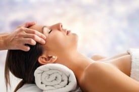 Woman having relaxing facial massage.